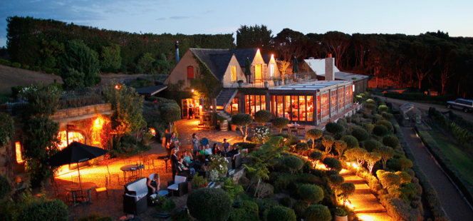 Mudbrick winery outside at night with lights on