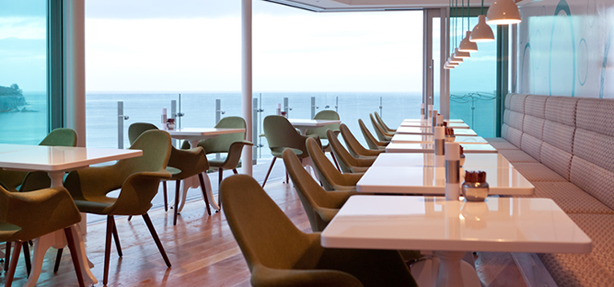 Wai Kitchen dining area with sea view
