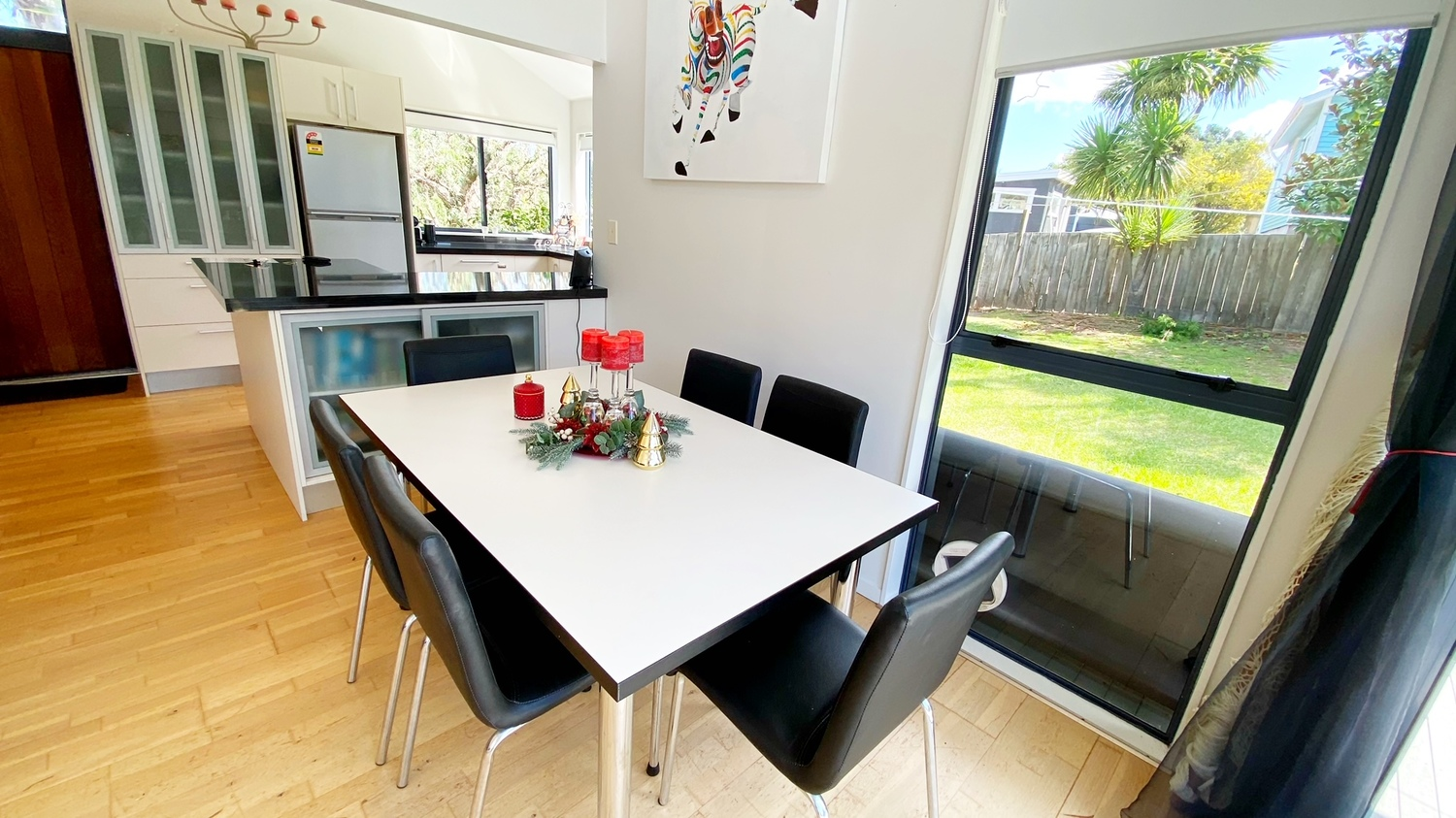 2._Woodlands_dining_table_chairs_through_to_kitchen.msg_1500x843.jpg
