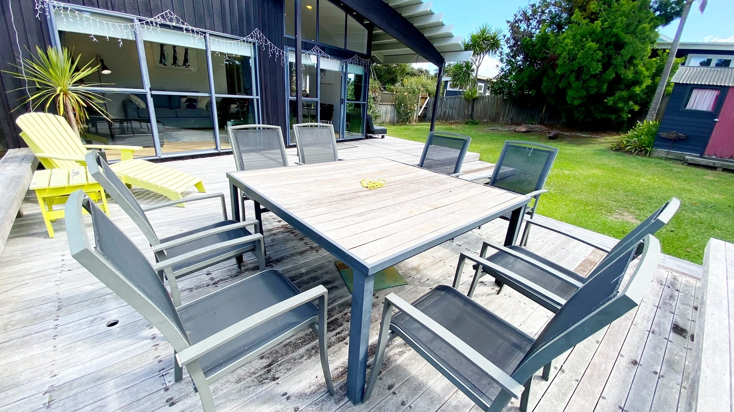 6._Woodlands_deck_with_dining_and_lounger_looking_towards_house.msg_1500x843.jpg