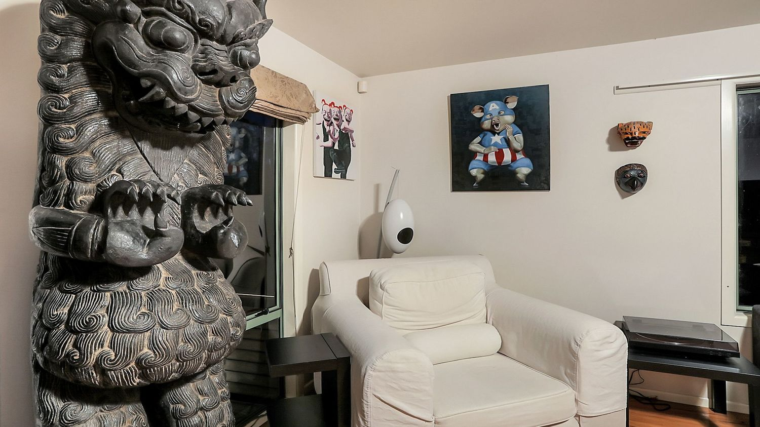 32._Seaview_with_statue_artwork_and_white_armchair_and_weird_artwork_1500x843.jpeg