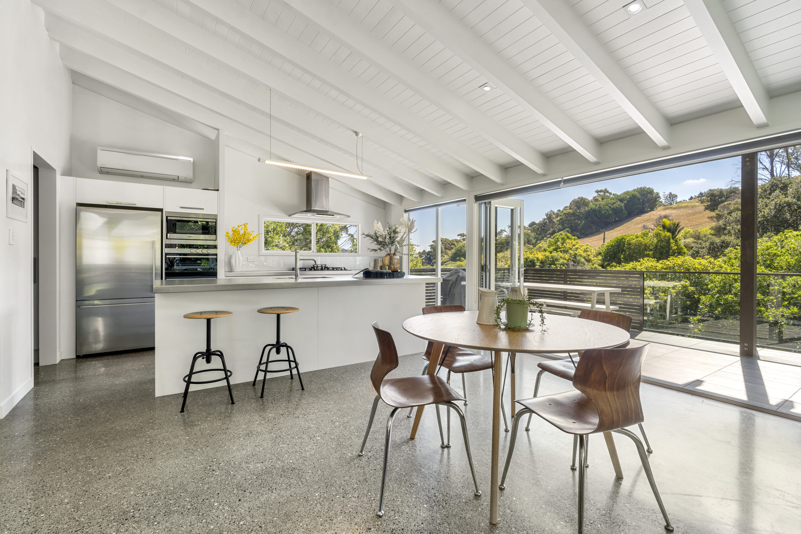 15.-Dining-and-kitchen-looking-outside-to-hillside-across-road-scaled.jpg