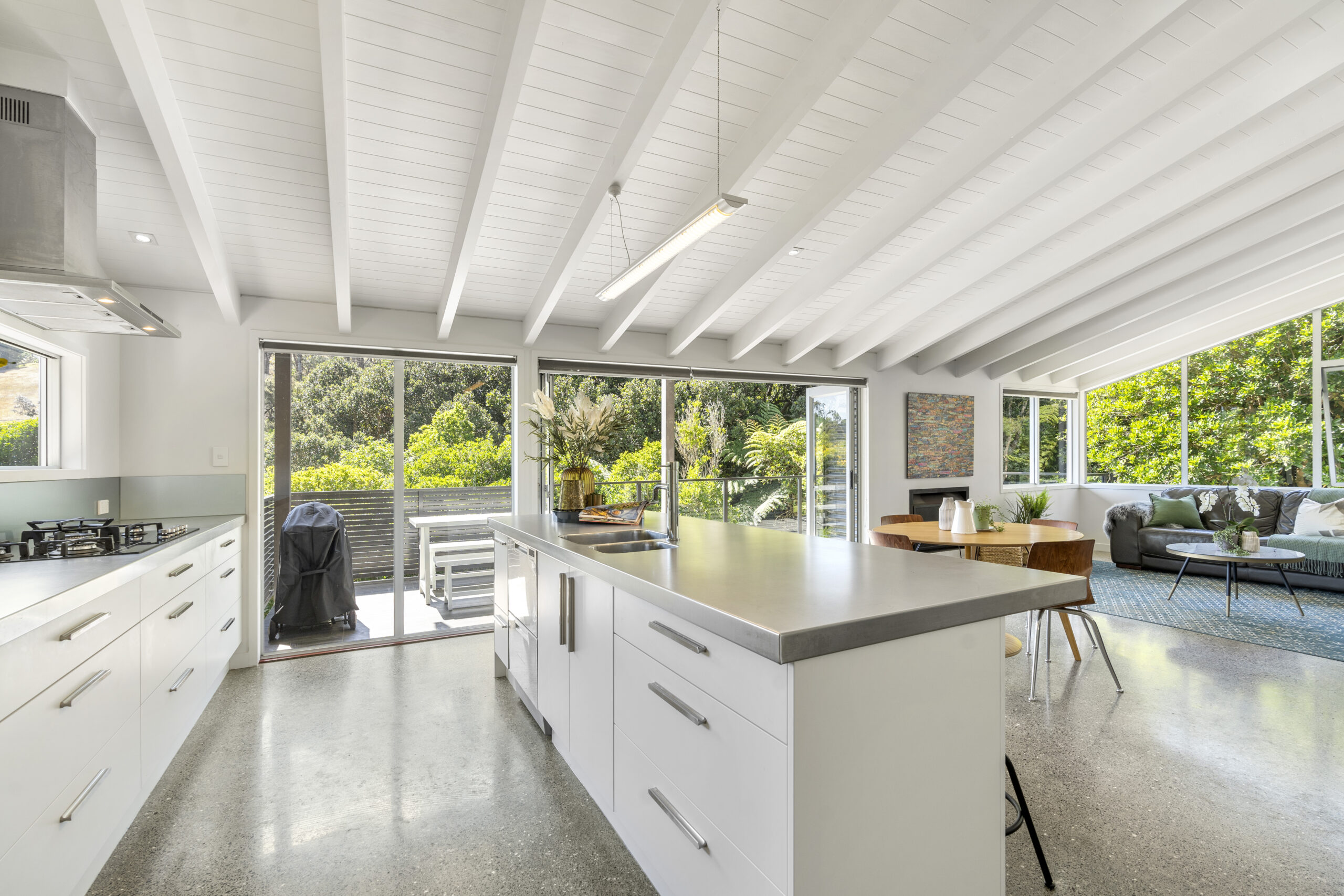 20.-Kitchen-to-verandah-and-lounge-scaled.jpg