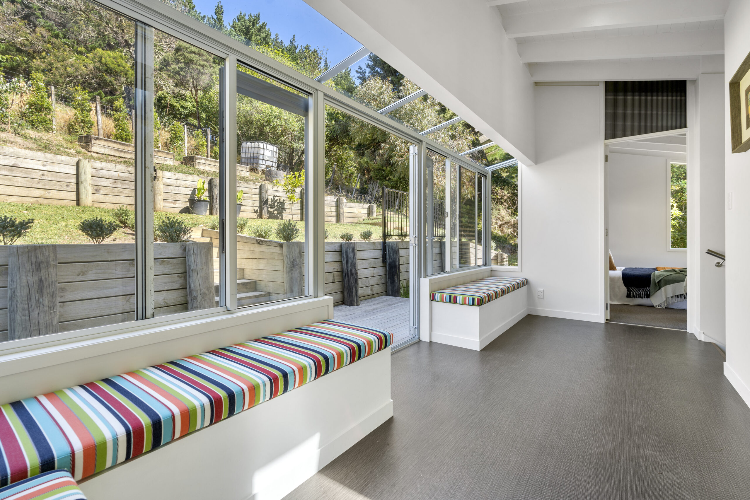 28.-Upstairs-seating-area-looking-out-to-back-deck-and-view-of-one-bedroom-scaled.jpg
